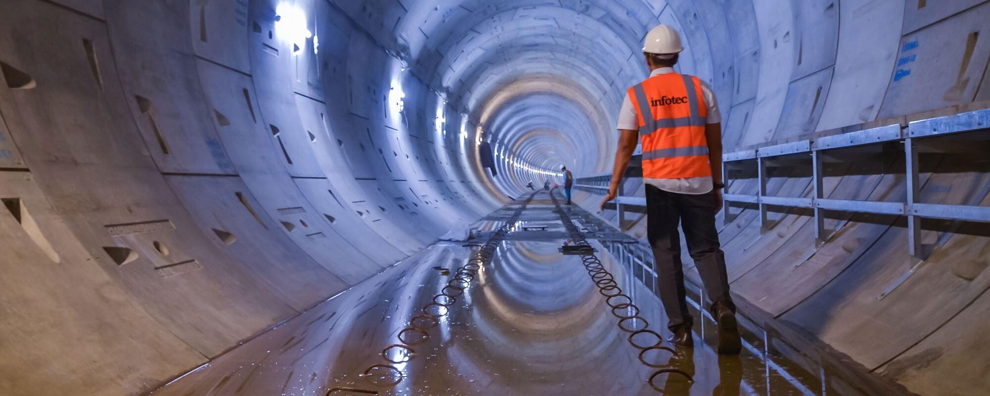 Man walking through underground tunnel